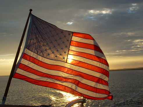 American Flag over the water - photo image